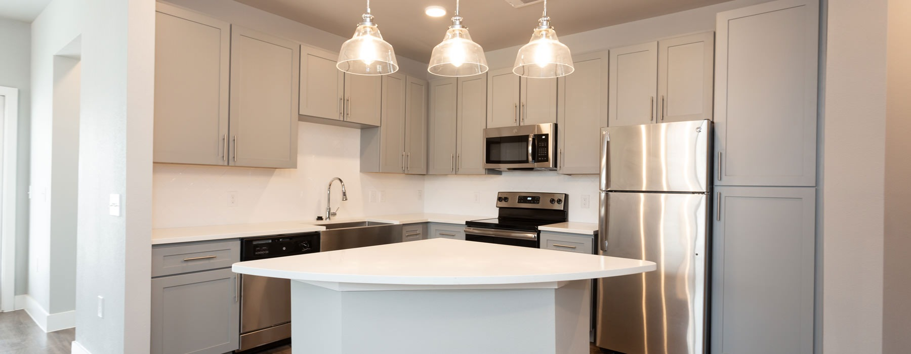 bright kitchen with pendant lighting over kitchen island