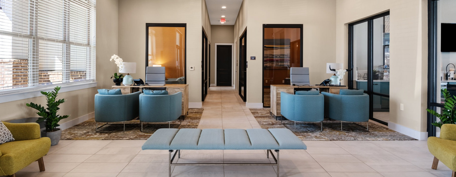 Beautiful lobby area with high ceilings and natural lighting